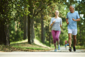 An older couple exercising and staying healthy thanks to the effects of florical capsules.